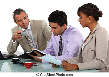 Three people having a business meeting