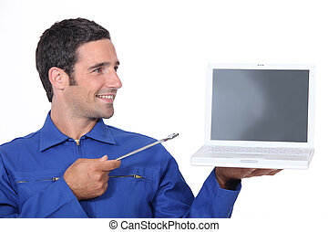 Man with a spanner and laptop computer