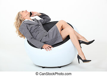 Relaxed businesswoman on phone