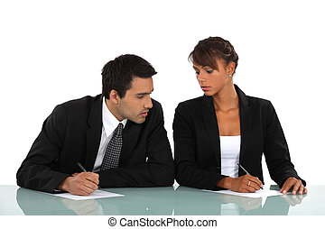 Man and woman working at a desk