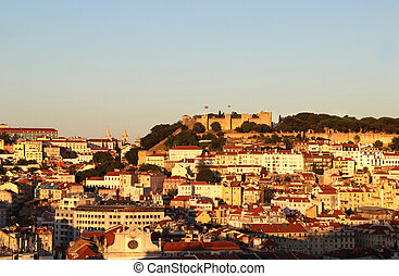Sunset in Lisbon, Portugal panorama of buildings, roofs,...