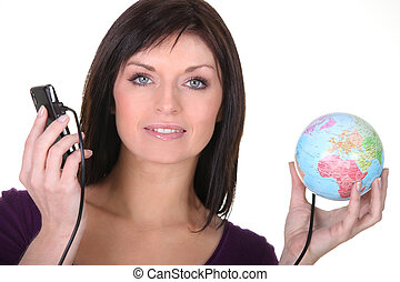 Woman with telephone plugged into globe