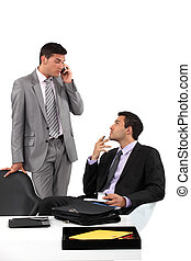Businessmen patiently waiting for their client to arrive at a meeting