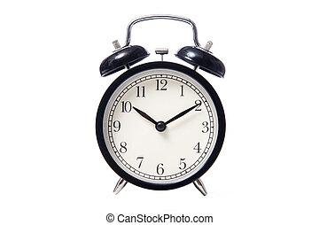 Black classic style alarm clock isolated on white