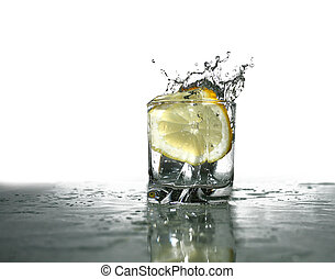Splashing Lemonade - Glass of cold clear splashing water...