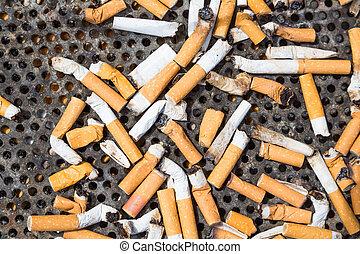 Cigarettes in a big iron ashtray