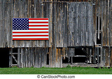 Proud American - American flag attached to old dilapidated...
