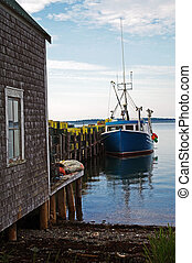Lobster Boat at Dock - A lobster boat at dock with traps...