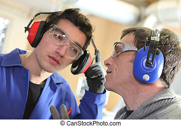 Men wearing ear defenders