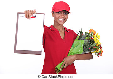 A woman delivering flowers.