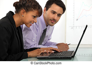 young businessman and businesswoman working together