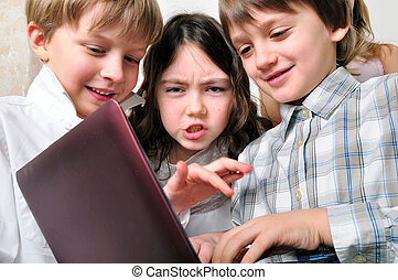 group of children friends playing studying at laptop - group...