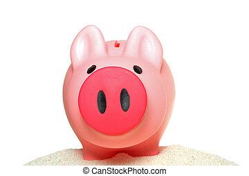 Piggy bank on sand