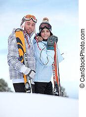 Couple about to ski down mountain