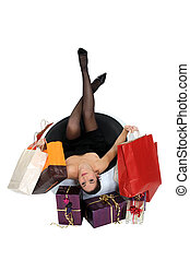 Woman with shopping bags and presents