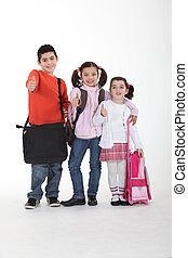 Three schoolkids with bags