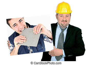 portrait of foreman holding picture of young tiler