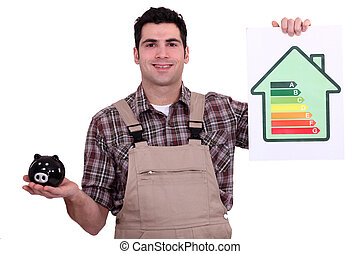 Man in overalls holding piggy bank and chart of energy consumption