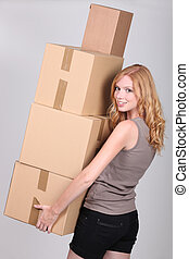 young woman holding cardboxes