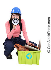A female construction worker promoting recycling.