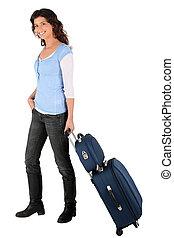Brunette wheeling luggage