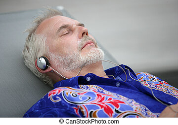 senior relaxing and listening music