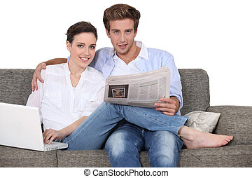 Couple relaxing in their living room