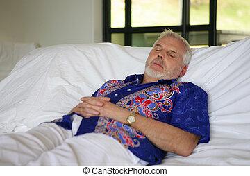 Older man asleep in bed