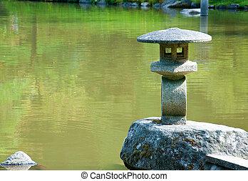 Lantern on the pond in japanese garden