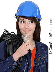 Female electrician with a lightbulb