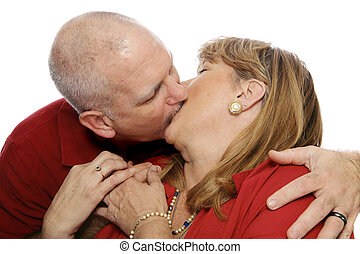 Passion in Marriage - Happy mature couple kissing...