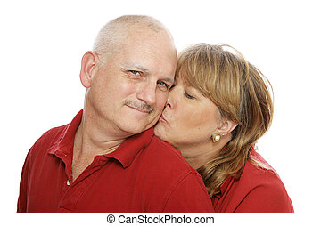 Happy Husband - Happy middle aged man receiving a kiss from...