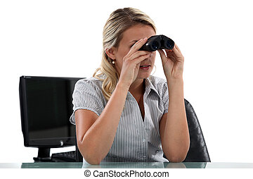 Woman with binoculars in the Office