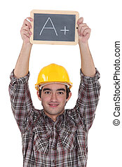 A construction worker holding a slate.