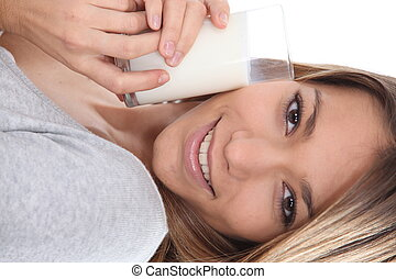 Woman drinking a glass of milk