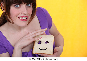 woman making a face in a slice of bread