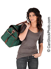 Woman carrying a duffel bag