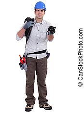 Building worker holding piggy bank on white background