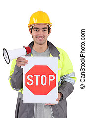 Tradesman holding a stop sign and a megaphone