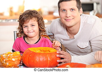 Girl emptying pumpkin