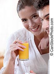 Couple drinking fruit juice