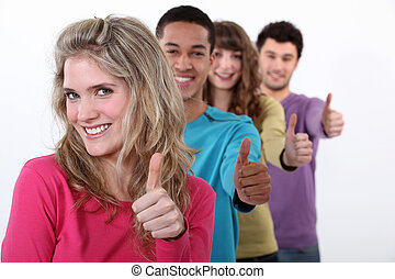 Young group of people giving the thumbs up