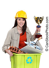 Female builder holding award for recycling