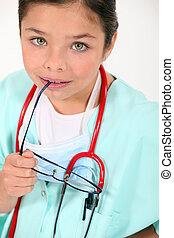 Little girl dressed as doctor
