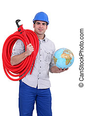 portrait of young plumber holding globe with hose over his shoulder