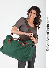 Woman with bag ready to go