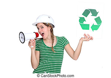 craftswoman holding a recycling label and talking through a megaphone