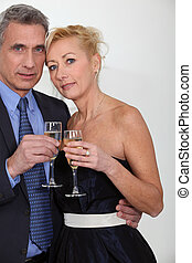 Mature couple toasting with champagne
