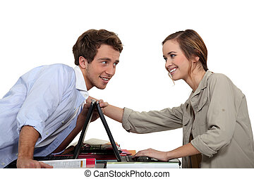 Young couple competing with laptops
