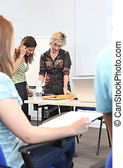 A teacher reviewing a student's work